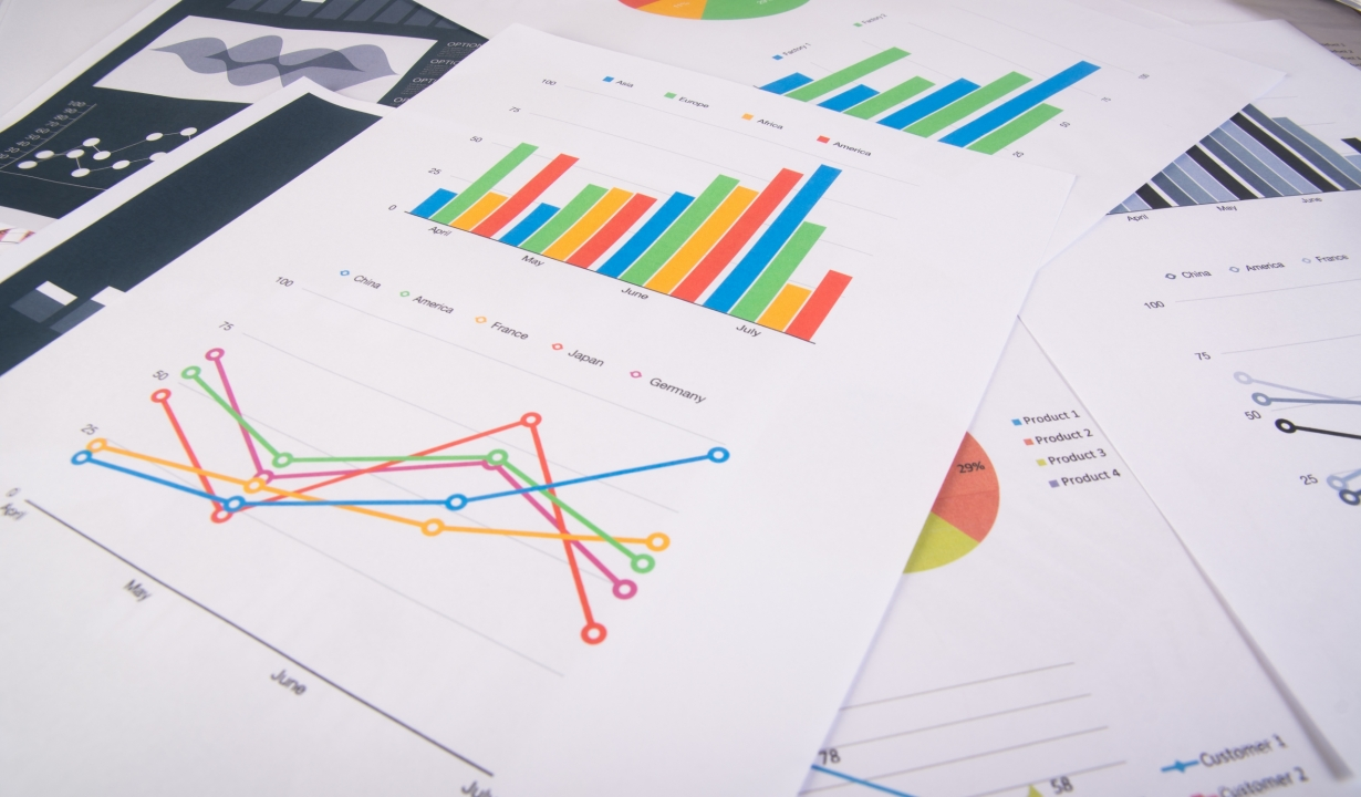 Business report. Graphs and charts. Business reports and pile of documents. Business concept.